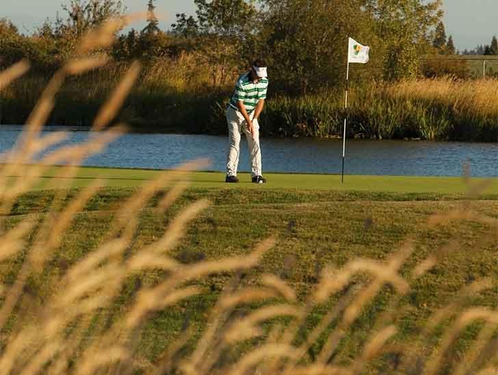 Man playing golf at Pumpkin Ridge Golf Club in Tualatin Valley