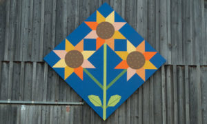 The blooming farm sunflower quilt barn block