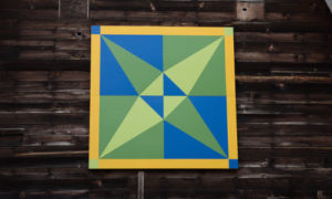 Crossed canoes quilt barn