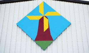 The Duyke Machine windmill quilt barn block