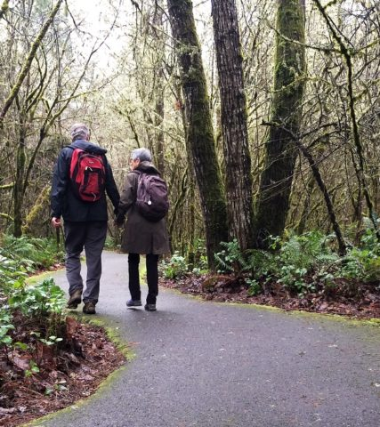 Couple walking in a nature park